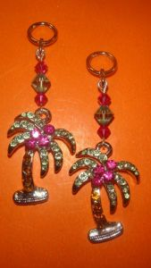 Palm tree charms for hearing aids